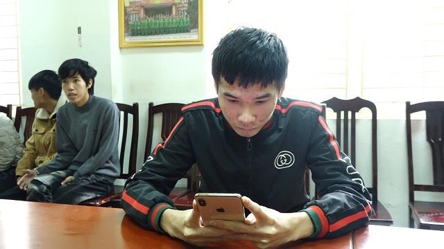 Trần Đạo Nghĩa tại cơ quan điều tra. Ảnh: Nguyễn Ngoan.