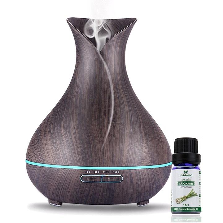 Máy khuếch tán tinh dầu FX2020 hình bình hoa màu nâu, tặng kèm tinh dầu sả chanh 10 ml, có tác dụng đuổi muỗi, khử mùi. Máy giúp tạo độ ẩm không khí, tỏa ra sương mát, tiết kiệm điện năng và tự động ngắt hoạt động khi mức nước thấp.