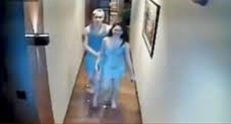 Christine Angelica Dacera ôm người đàn ông được cho là nghi phạm.