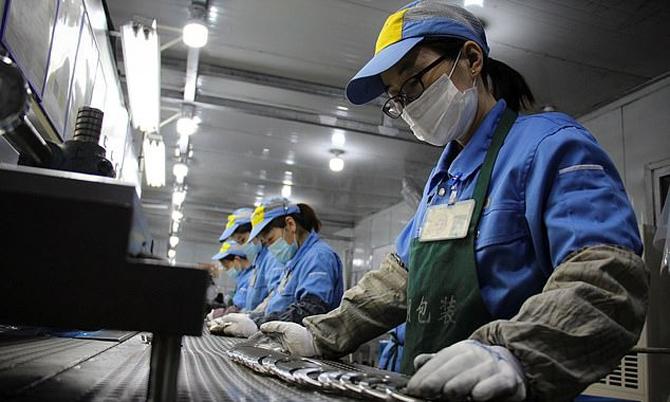 Công ty Trung Quốc kiểm soát số lần đi vệ sinh của nhân viên. Ảnh: AFP.