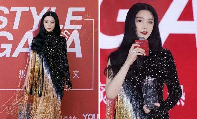 Ngôi sao gốc Hoa ăn mặc nổi bật khi dự sự kiện.