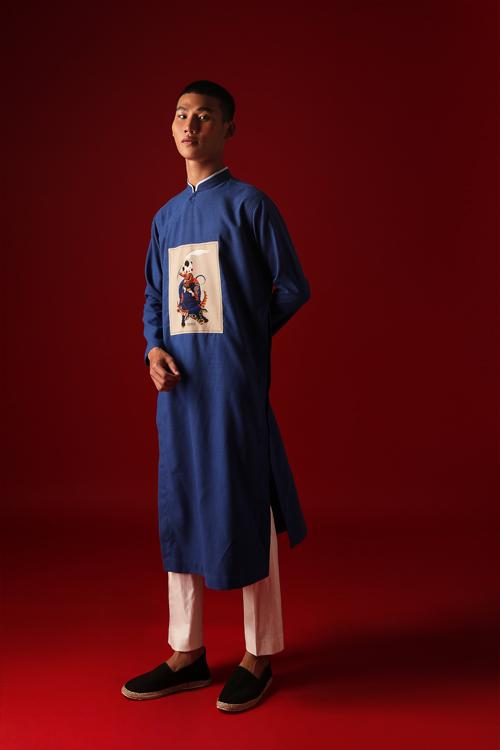 Ngoài váy áo cho phái đẹp, hình ảnh đồng quê và chú trâu còn đưa đưa vào các mẫu áo dài - trang phục hot trend- mỗi dịp Tết đến xuân về.