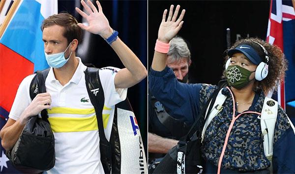 Á quân đơn nam Australia Mở rộng Daniil Medvedev (trái) và tân vương đơn nữ Australia mở rộng Naomi Osaka được khen vì vẫn đeo khẩu trang ra sân dù không bắt buộc. Ảnh: AFP.