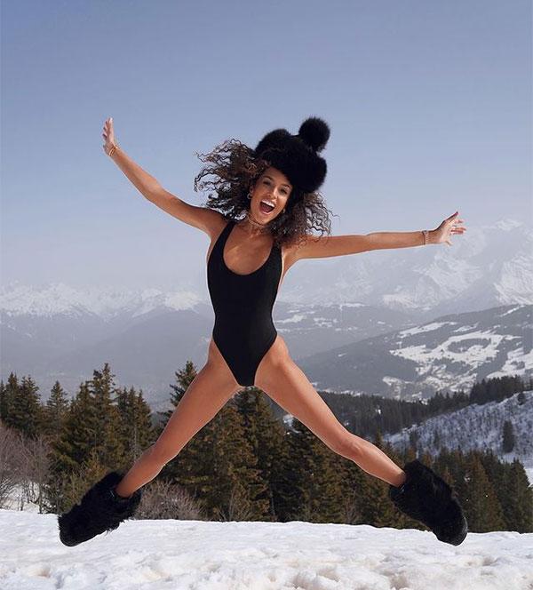Nàng mẫu cá tính thỏa thích chơi đùa như đứa trẻ trên tuyết.