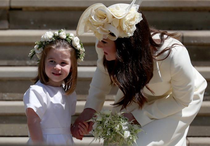 Xích mích của chị em dâu hoàng gia được cho là liên quan tới váy phù dâu của Công chúa Charlotte ở đám cưới Harry - Meghan hồi năm 2018. Ảnh: PA.