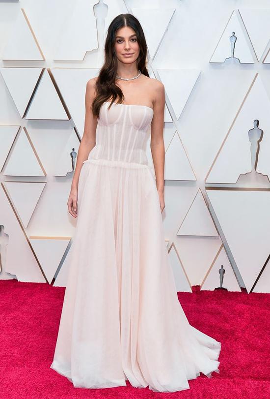 Camila Morrone at the 2020 Academy Awards wearing a bridal gown by Carolina Herrera