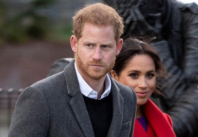 Vợ chồng Harry - Meghan dự một sự kiện năm 2019, trước khi rời hoàng gia. Ảnh: UK Press.