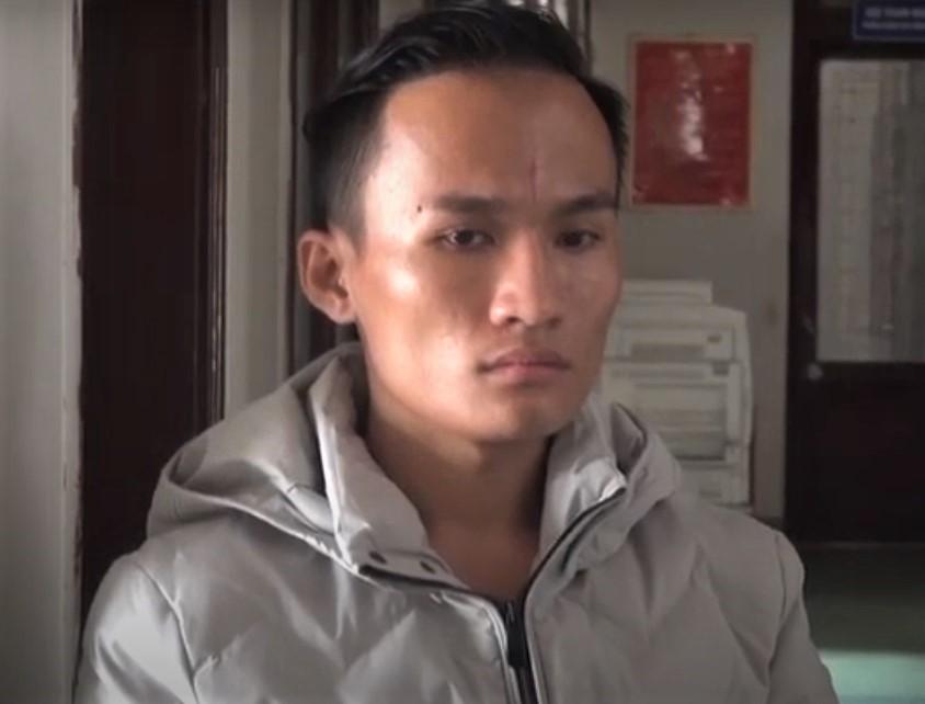Phạm Ngọc Tiên tại cơ quan công an.  Ảnh: Phạm Linh.
