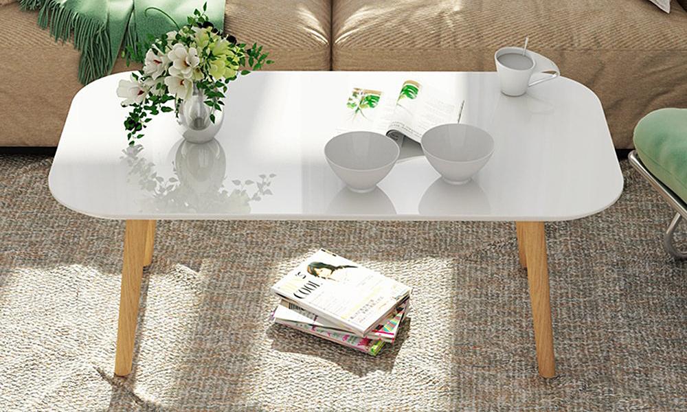 Bàn trà sofa GP101của nội thất IGEA mang phong cách Bắc Âu tối giản, cao 42 cm với 4 chân làm từ gỗ sồi, lộ rõ vân gỗ. Mặt bàn hình chữ nhật màu trắng, rộng 50 cm, dài 90 cm, được bo tròn 4 góc, làm từ gỗ MDF phủ melamin chống xước chống nước. Sản phẩm bảo hành 12 tháng, đang được giảm giá 18% còn 245.000 đồng.