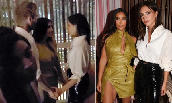 Vợ chồng Becks nắm tay nhau khi nói chuyện với Kim Kardashian. Ảnh: The Sun.
