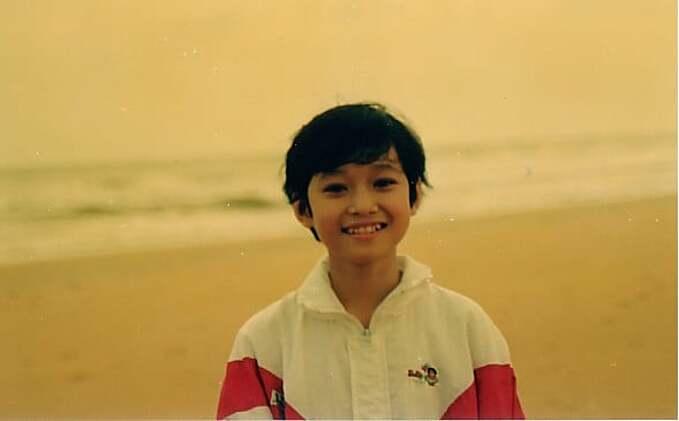 Ca sĩ Quang Vinh đăng ảnh thời bé và được khen đẹp từ nhỏ.