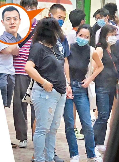 Lưu Minh Vỹ và cô bạn gái Joyce nắm tay nhau.
