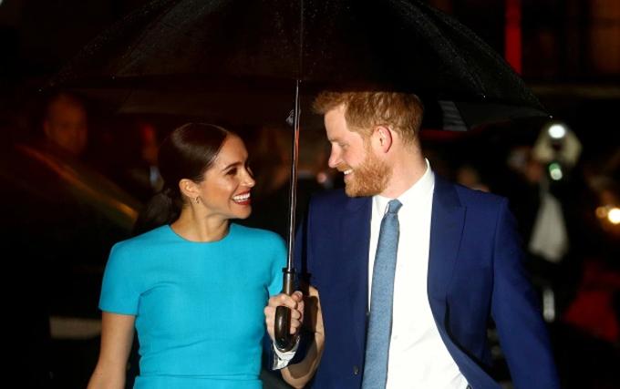 Harry và Meghan dự một trong những sự kiện cuối cùng với tư cách thành viên hoàng gia cao cấp ở Anh hồi tháng 3/2020. Ảnh: Reuters.