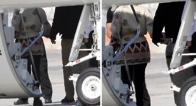 Jennifer Lopez và Ben Affleck nắm tay nhau tại sân bay ở Los Angeles.