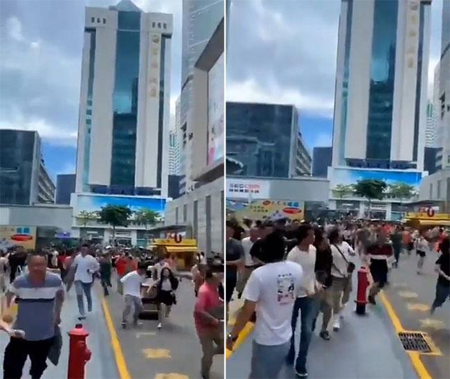 Người dân, nhân viên văn phòng bỏ chạy để tránh xa toà nhà rung lắc tại thành phố Thâm Quyến hôm 18/5. Ảnh: Weibo.