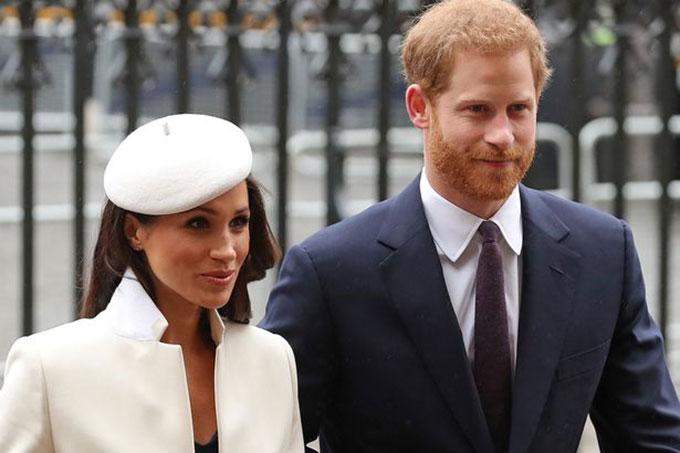 Vợ chồng Harry và Meghan khi còn là thành viên cao cấp của hoàng gia Anh. Ảnh: AFP.