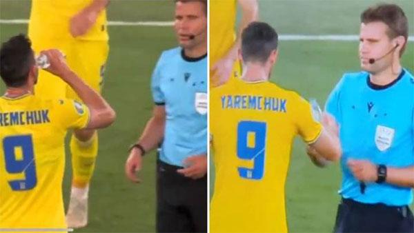 Trọng tài gây tranh cãi khi uống chung chai nước với Yaremchuck. Ảnh:YT.