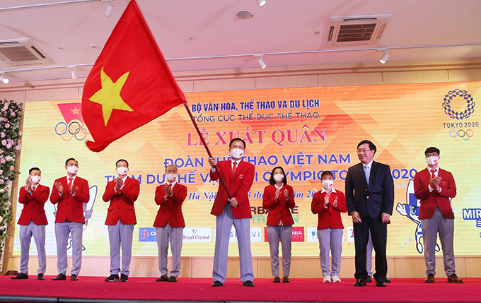Đoàn thể thao Việt Nam tổ chức lễ xuất quân dự Olympic Tokyo 2020 tối 13/7. Ảnh: Quý Lượng.
