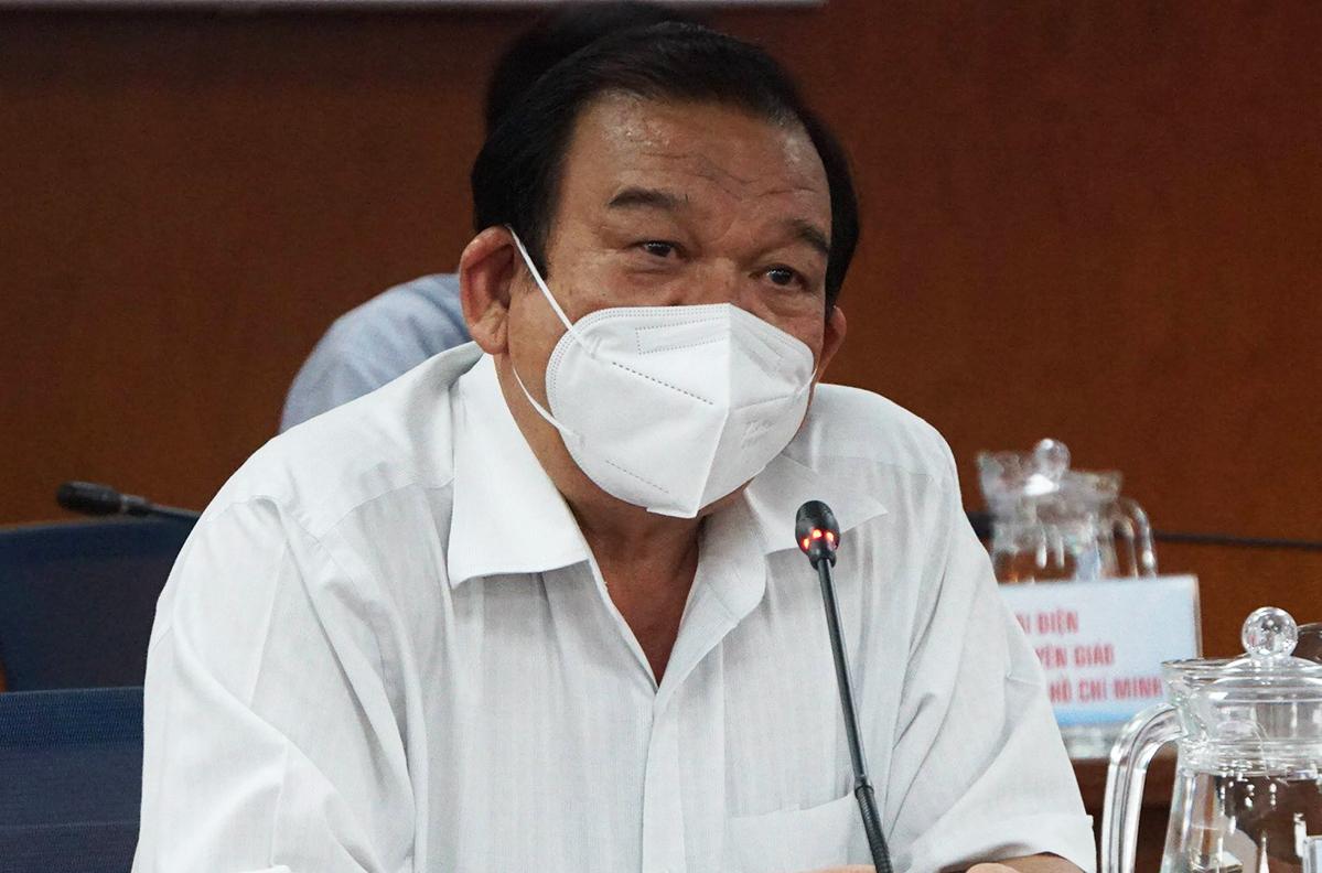 Giám đốc Sở Lao động, Thương binh và Xã hội Lê Minh Tấn tại buổi họp báo chiều 21/7. Ảnh: Mạnh Tùng.