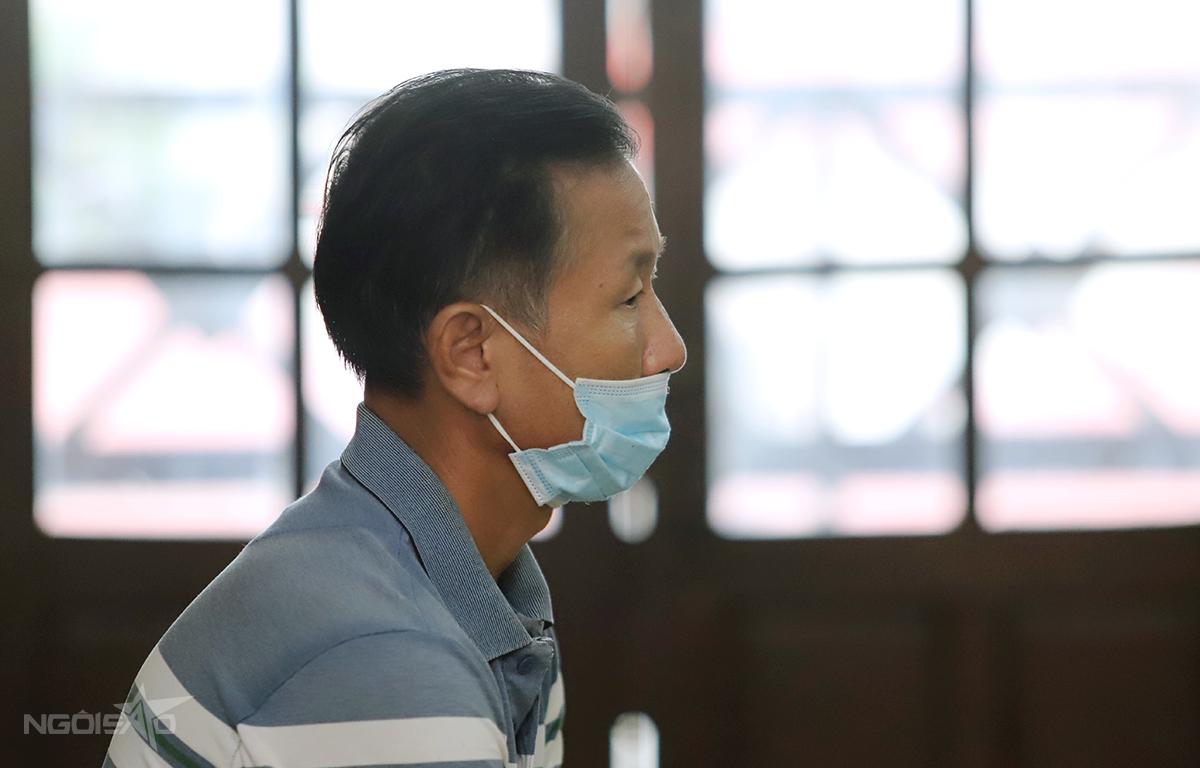 Bị cáo Nghệ tại phiên xử sáng 23/7. Ảnh: Hùng Lê