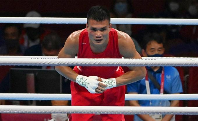 Văn Đương chia tay Olympic Tokyo 2020 với một chiến thắng ở trận ra quân. Ảnh: AFP.