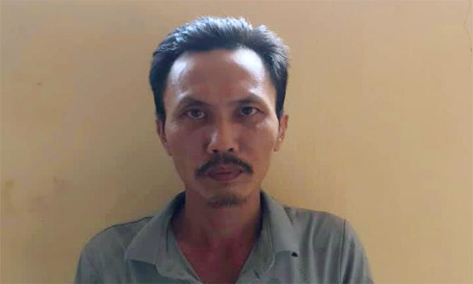 Nghi can Thuận tại cơ quan điều tra. Ảnh: Công an cung cấp