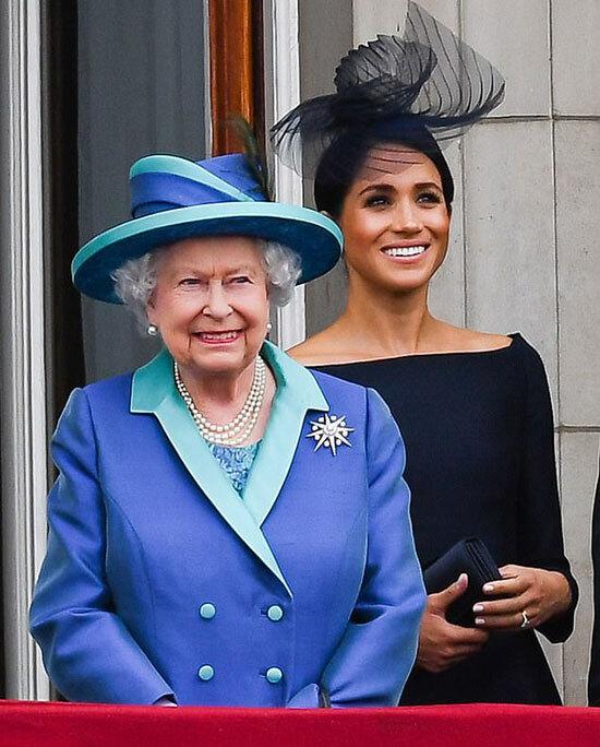 Meghan và Nữ hoàng Anh trên ban công điện Buckingham năm 2018. Ảnh: PA