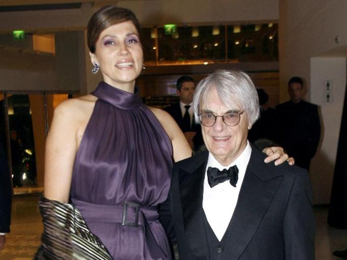 Slavica và Bernie Ecclestone. Ảnh: AFP